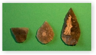 A leaf shaped arrowhead, a chisel and a point